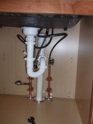 Newly installed kitchen sink drain and water lines from Docs Plumbing LLC in Norwich, CT 06360