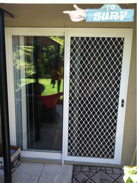 Sliding security screen door. from Screenmobile in Los