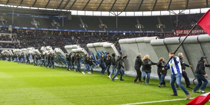 They bring down the symbolic 'Berlin Wall' in a match in Bundesliga