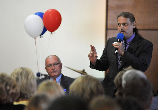 Boman Speaks as Hoekstra looks on in Grandville on May 14th.