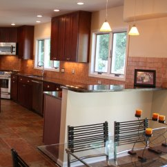 Images Of Remodeled Kitchens Kitchen Trash Bins Kalamazoo Woman 39s Includes Solid Cherry