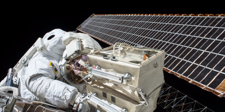 Photo of astronaut working on space station during space walk and representative of content marketing tools