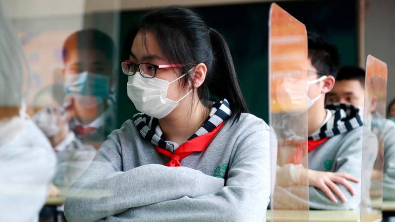 Students wearing face masks have a class at a middle school on April 27, 2020 in Shanghai, China.