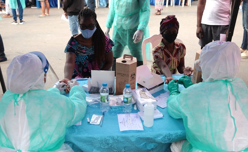 Healthcare professionals run serological tests for Covid-19 in Luanda, Angola