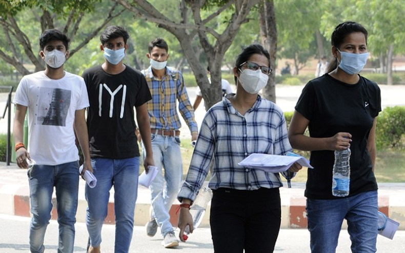 Candidates arrives to appear for semester exams held by Abdul Kalam Technical University (AKTU), Noida, India.