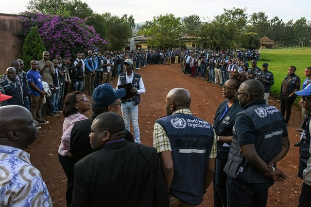 WHO staff members talking to people in Butembo, DRC