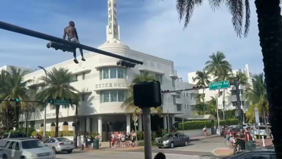 Man Arrested in Miami Beach After Climbing Traffic Signal Post in Viral Video