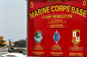 A Camp Pendleton-based Marine sergeant and his wife were tortured before they were shot execution-style, according to a published report.