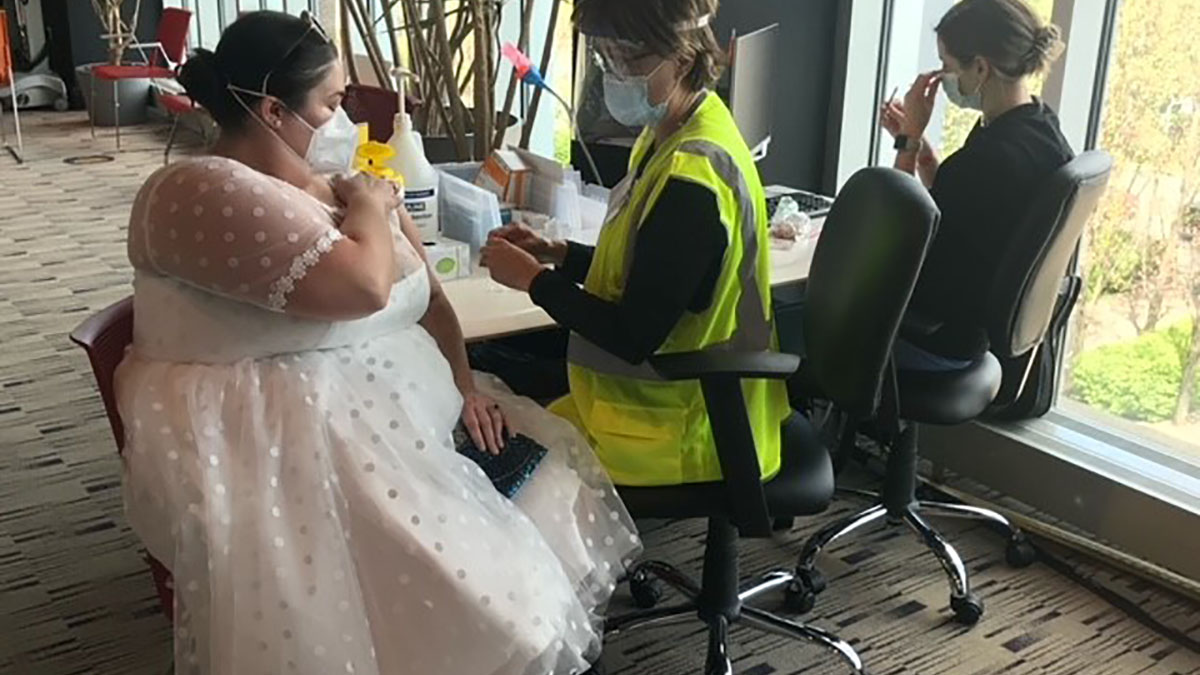Wedding Reception Gown Neglected Due to Pandemic Worn to Vaccination Instead