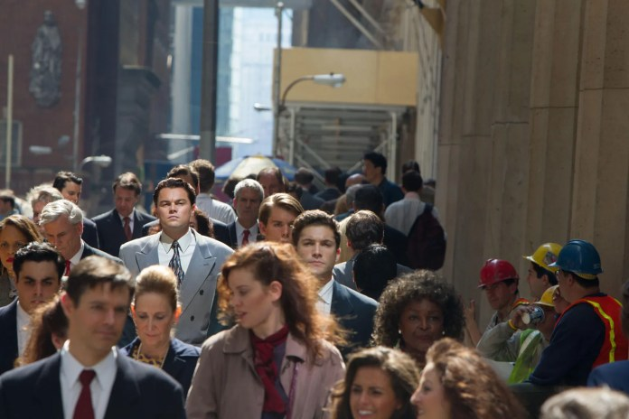 This image may contain Leonardo DiCaprio Suit Coat Clothing Overcoat Apparel Human Person Helmet Crowd and Audience