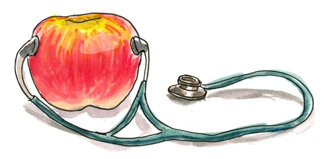 A stethoscope listening to an apple.