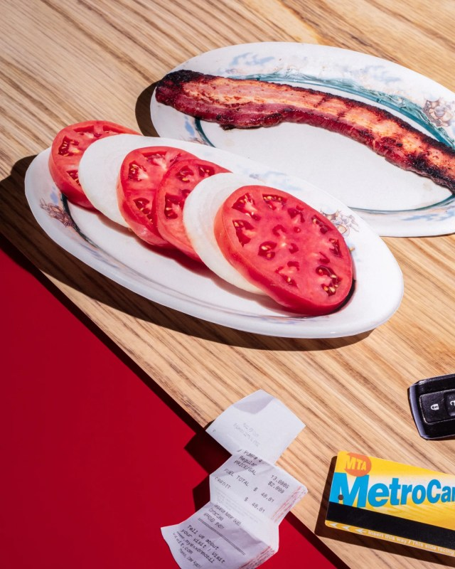 The notoriously priced tomatoandonion appetizer  a slab of thickcut bacon.