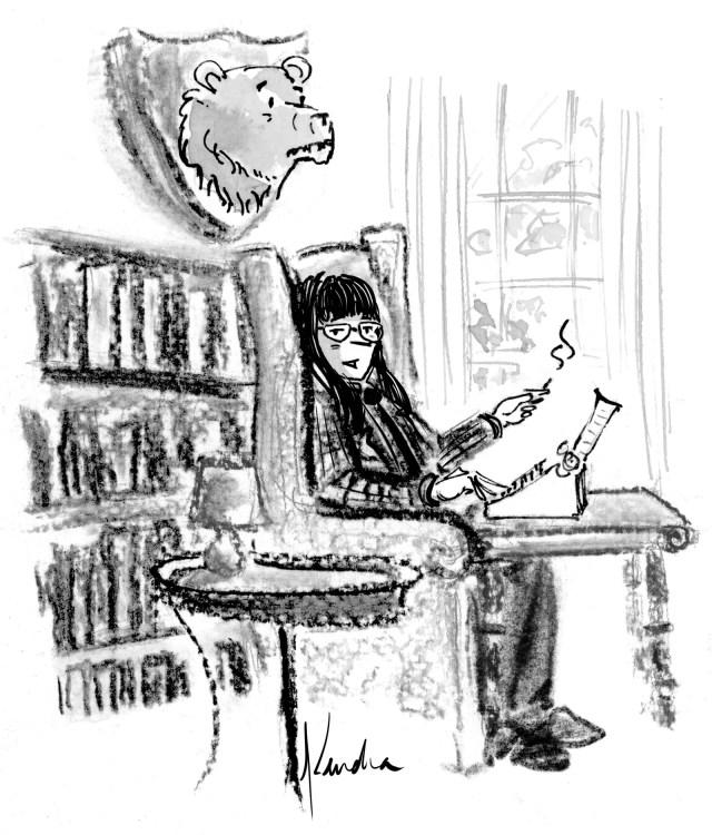 Emma sitting in a study.