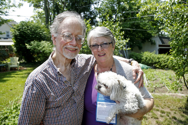 Lance Morrow and Kathleen Reilly with Cornelius. The couple says they visited Banfield Pet Hospital inside a PerSmart store for a free exam for Corny, but they ended up with a bill that went to collections.