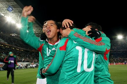 Mexican soccer players celebrating World Cup win, wire