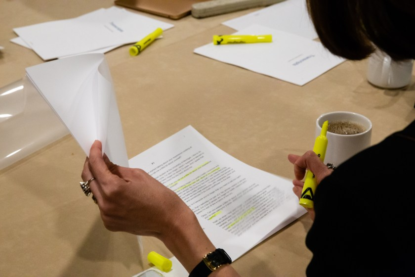 Photo of a team member highlighting a printed transcript.