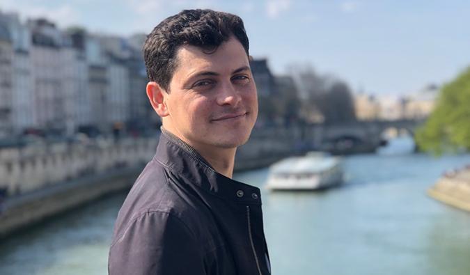 Matt Kepnes on a bridge over a canal in Paris
