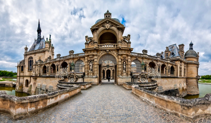The intricate stone architecture of the historic Chantilly chateau in France