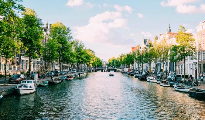 A boat tour of the canals of Amsterdam on a sunny day