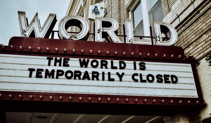 A movie theatre marquee stating the world is closed