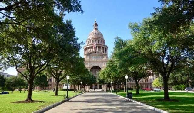 The State Capitol building in Austin, Texas on a bright summer day