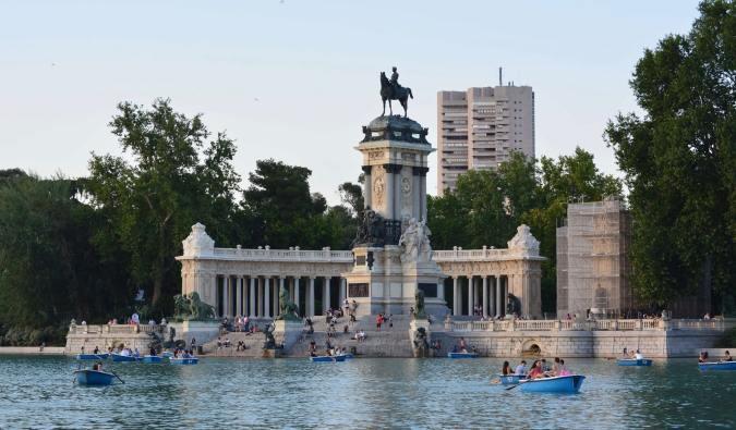 People in rowboats on the lake in El Retiro Park in Madrid, Spain