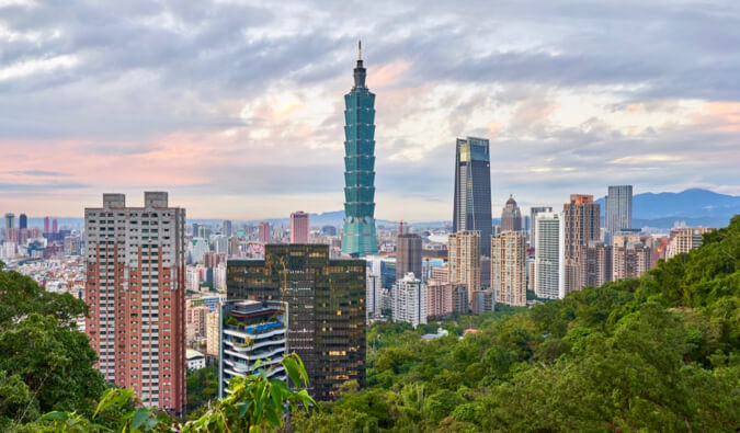 The skyline of Taipei in Taiwan, surrounded by greenery