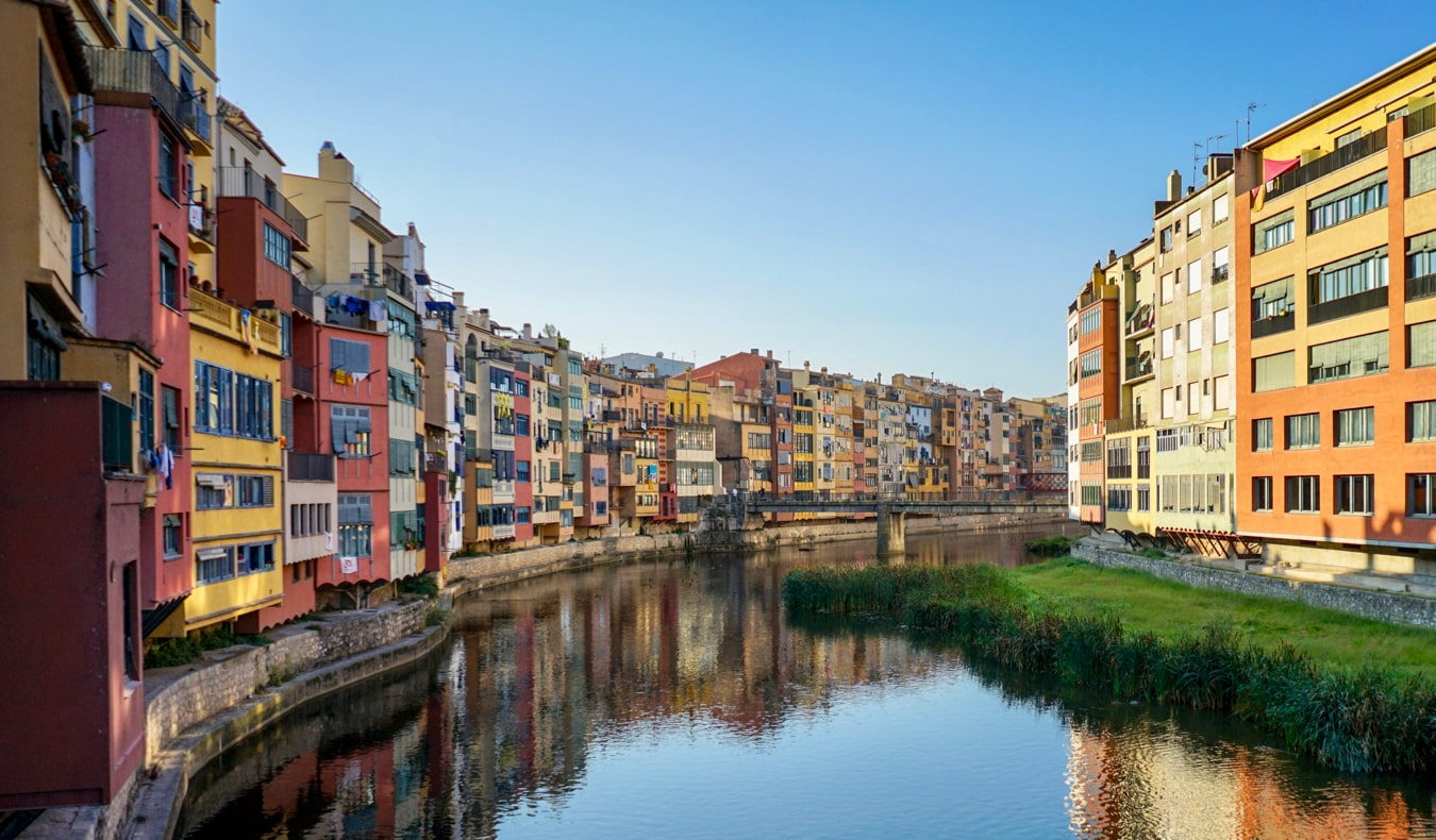 The colorful old buildings along the river in Girona, Spain