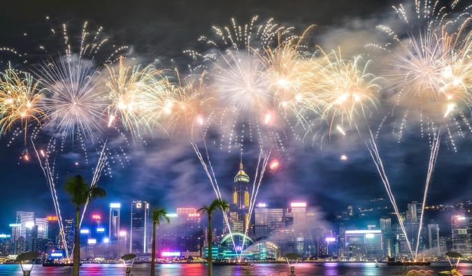 A massive New Year's fireworks display at night in Hong Kong