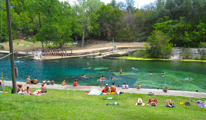 People relaxing at Barton Springs in Austin