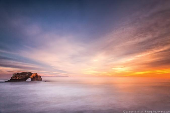 Photo of a beautiful, golden sunset over the ocean in Santa Cruz, California