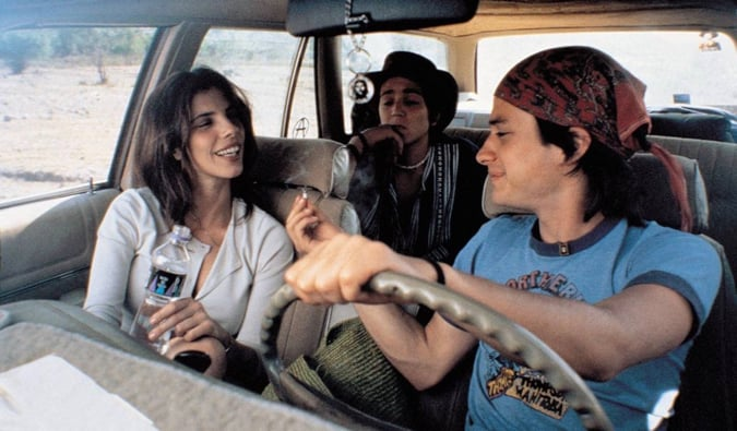 Three friends smoking in a car