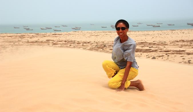 Teacher in Saudi Arabia poses on sand dune