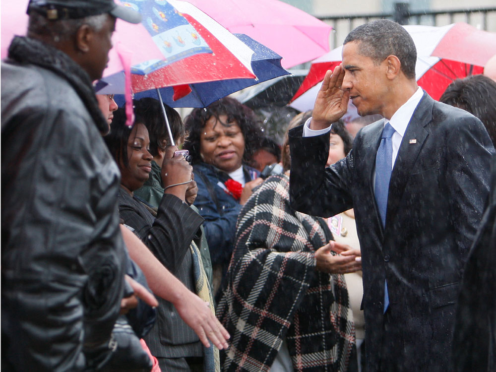 President Barack Obama returns a salute as he greets family members of victims of the Sept. 11 attacks after speaking at the Pentagon Memorial, marking the eighth anniversary of the attacks, Friday, Sept. 11, 2009. (AP Photo/Charles Dharapak)