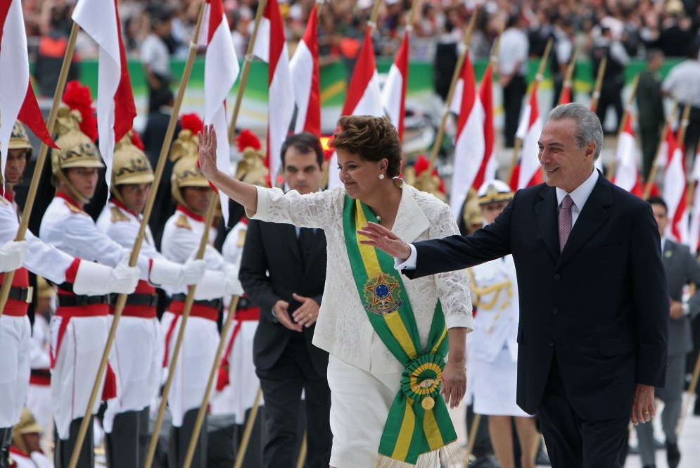 Newly sworn-in Brazilian President Dilma Rousseff and her vice president, Michel Temer, wave during their inauguration in Brasilia on Saturday.