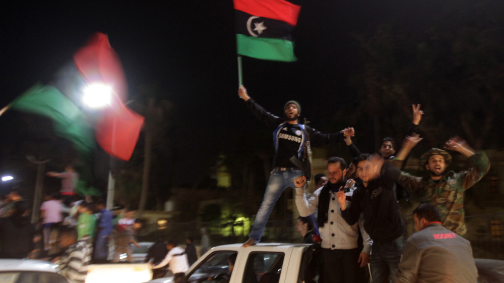 Libyan rebels celebrate in Benghazi on Thursday after the United Nations Security Council's resolution to impose a no-fly zone over Libya.