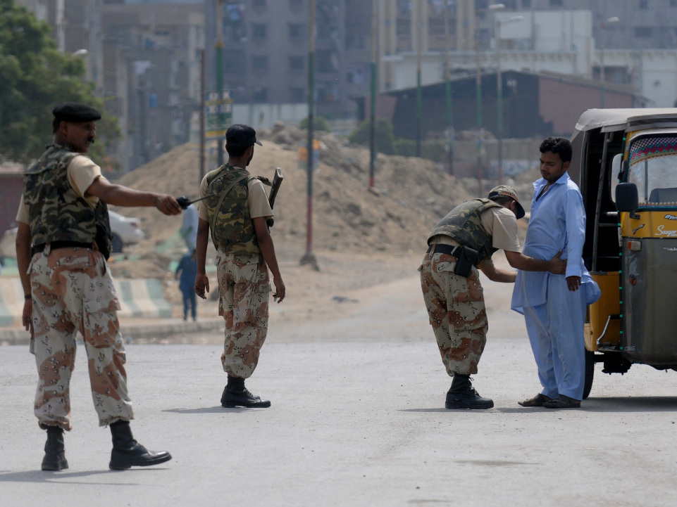 A Pakistani paramilitary soldier frisks a man on a cordoned-off street during house-to-house search operations against criminals, gangs and extortion mafias in a troubled area of Karachi on Aug. 28.