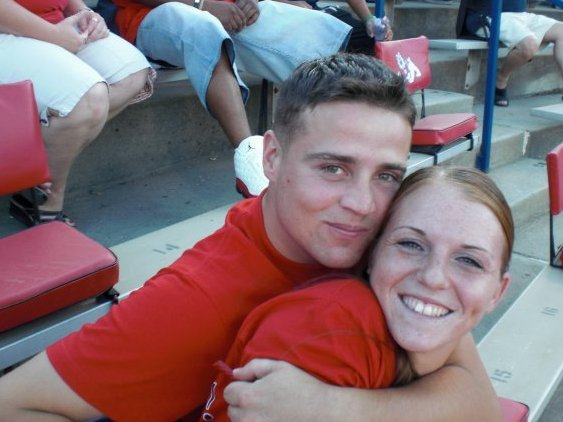 Cpl. Derek Wyatt is seen here with his wife, Kait, in Fresno, Calif., at a Fresno State football game. Wyatt was 25 when he died; his wife, 22.