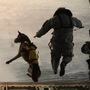 A U.S. Army soldier with the 10th Special Forces Group and his military working dog jump off the ramp of a CH-47 Chinook helicopter from the 160th Special Operations Aviation Regiment during water training over the Gulf of Mexico as part of exercise Emerald Warrior 2011 on March 1, 2011.