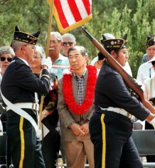 Gordon Hirabayashi, center, in 1999 at the former prison camp in Arizona where he was held for about a year. The camp was later renamed for him.