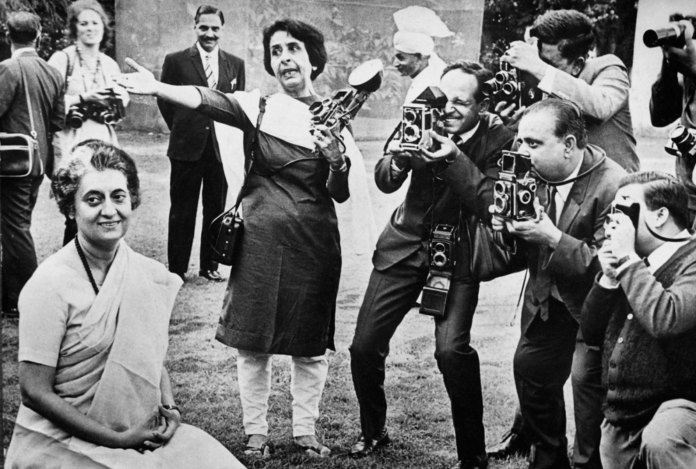 India's first female photojournalist, Homai Vyarawalla (center), seen with other press photographers at a photo session with Indira Gandhi in Delhi.