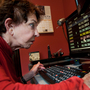 Sue Freeman, 78, checks her email at her home in Laguna Beach, Calif., on Saturday. She says her eyesight improved markedly since she received an experimental stem-cell procedure last July.