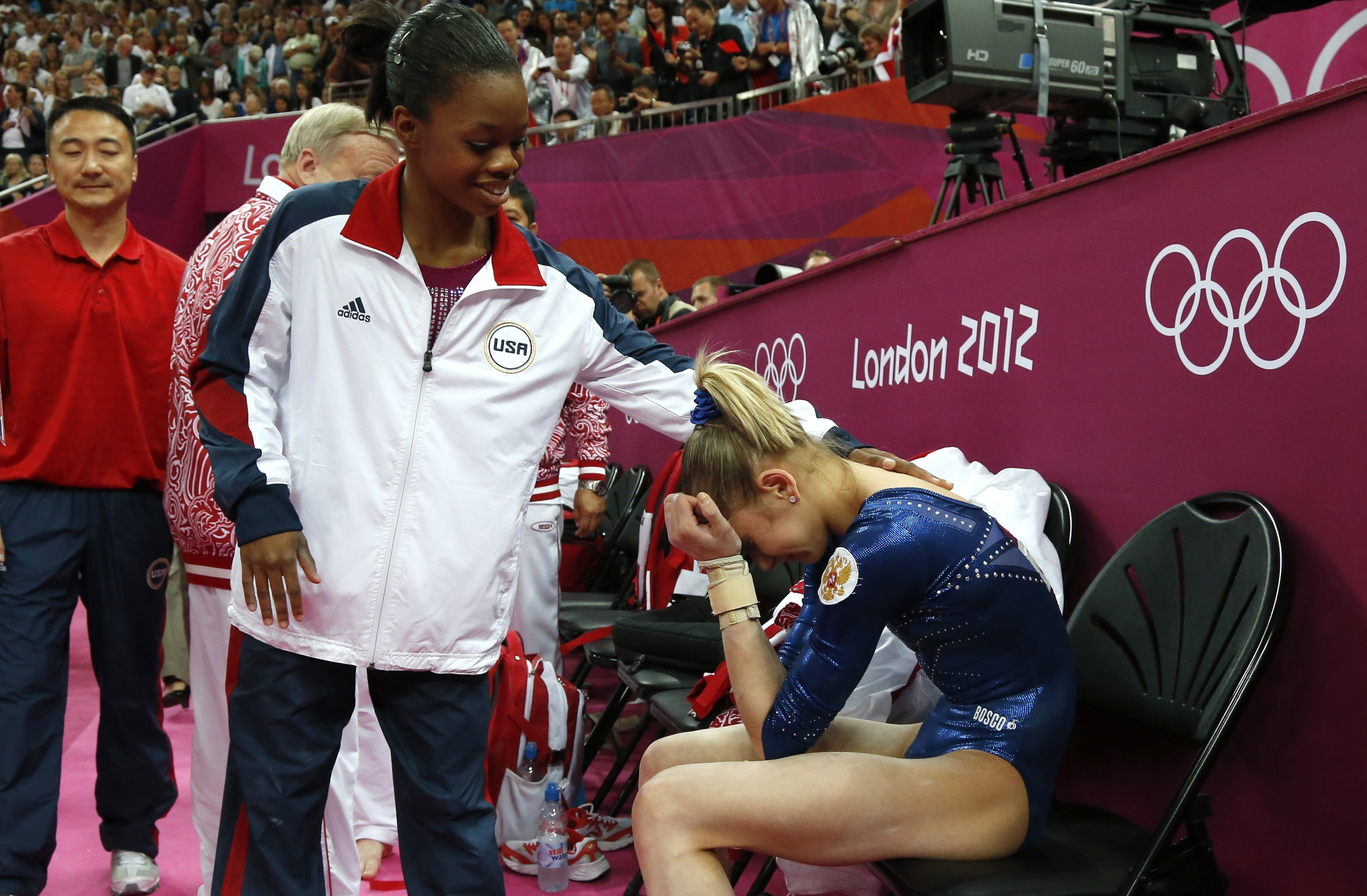 After Thursday's competition, American Gabby Douglas consoles silver medalist Victoria Komova of Russia.