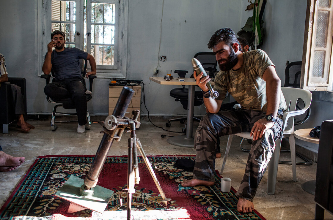 The Syrian rebels have no one source for their weapons and have had to scrape together their arsenal in various ways. Here, Abdel Hakim Yassin, a rebel commander in northern Syria, inspects a Yugoslav illumination mortar round that was brought to him by an Iraqi arms dealer.