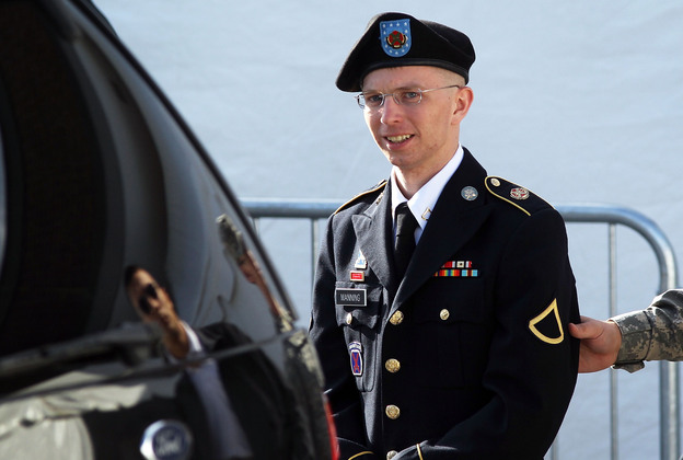 U.S. Army Private Bradley Manning is escorted as he leaves a military court in June.
