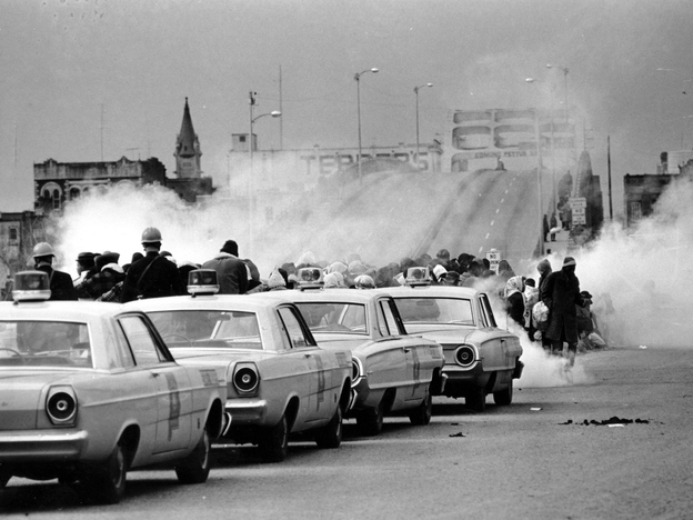 Tear gas fills the air as state troopers, ordered by Alabama Gov. George Wallace, to break up a march at the Edmund Pettus Bridge in Selma, Ala., on March 7, 1965, what became known as Bloody Sunday.