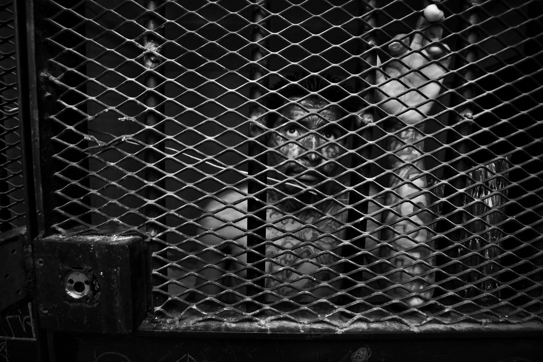 A gang member in an isolation cage — in the special block for prisoners who have been threatened by other inmates — at the maximum security prison Granja Penal de Pavon, Guatemala, 2009.