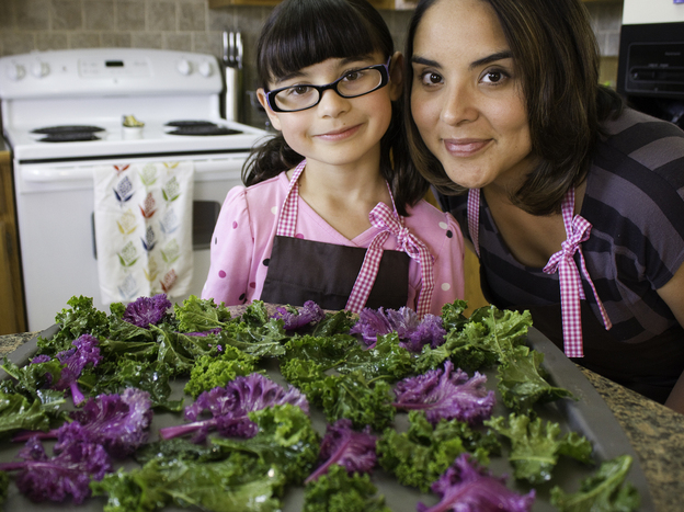 Hannah Robertson, 9, and her mom, blogger Kia Robertson — with the makings for kale chips, of course.
