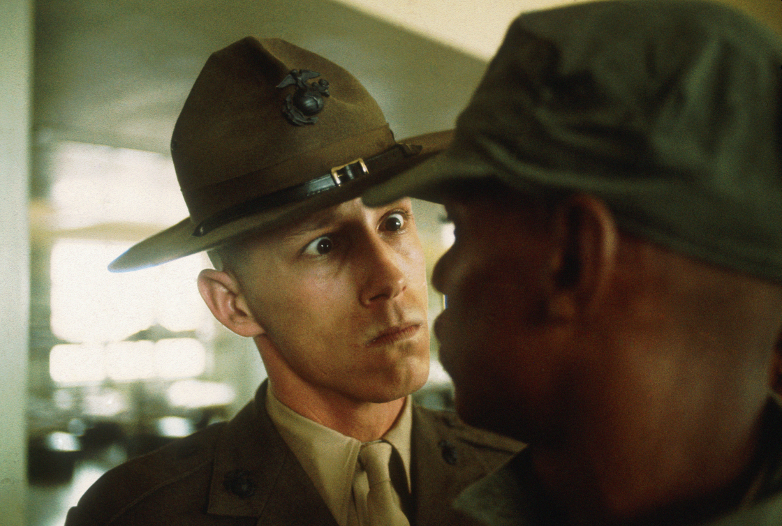 A U.S. Marine Corps drill instructor delivers a severe reprimand to a recruit, Parris Island, S.C., 1970.