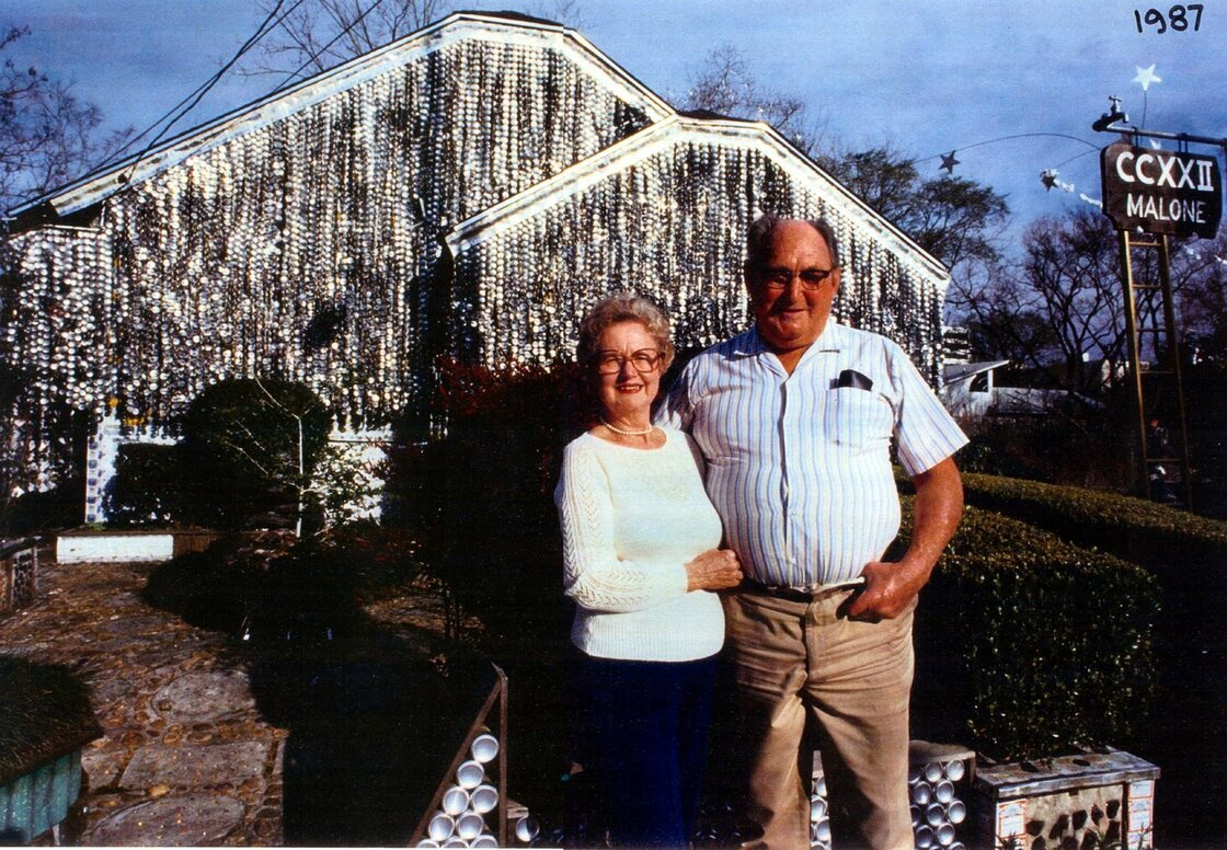 John and Mary Milkovisch in front of their Beer Can House in 1987.